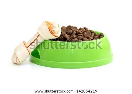 dog dish with food garnished with bone isolated on white - stock photo