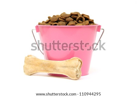 Dog Food and bone in a basket isolated on the white background - stock photo