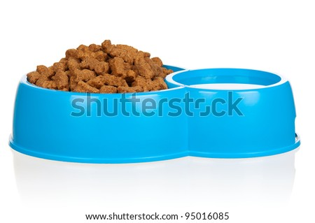 Dog food in bowl isolated on a white background - stock photo