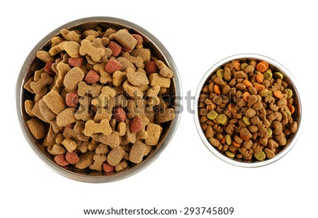Dog food in bowls, isolated on white - stock photo