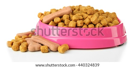 Dog food in pink plastic bowl on white background - stock photo