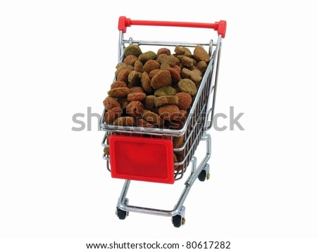 Dog Good in Shopping Trolly - stock photo
