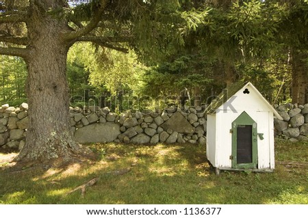 Dog house in the country - stock photo