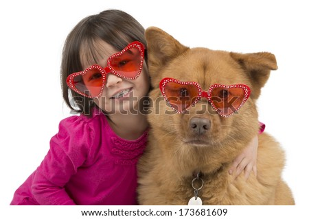 Dog hugged by child isolated on white background - stock photo