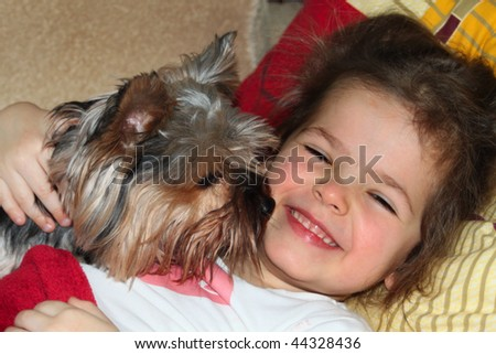 Dog kissing baby girl - stock photo