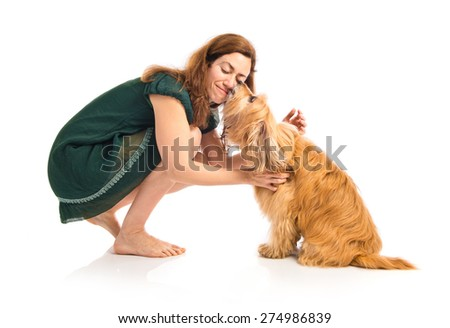 Dog kissing her owner - stock photo