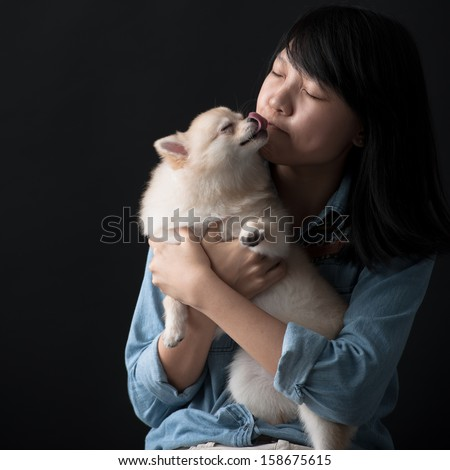 Dog kissing its owner - stock photo