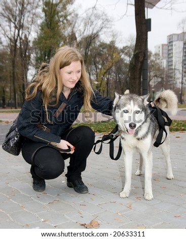 dog outdoor with owner - stock photo