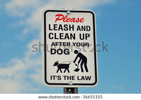 Dog Sign: Leash Up And Clean Up After Your Dog - stock photo
