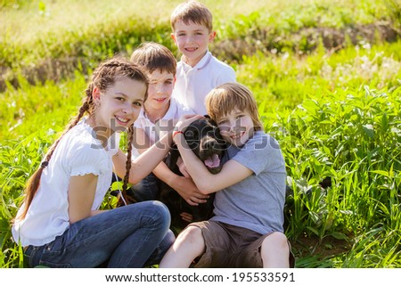 dog smiling with three young kids - stock photo