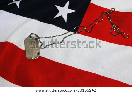 Dog tag on American Flag.Freedom is not free - stock photo