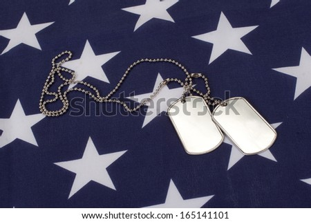 dog tags on american flag - stock photo