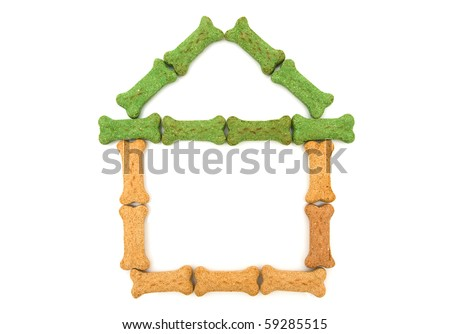 Dog treats in the shape of a house isolated on a white background, doghouse