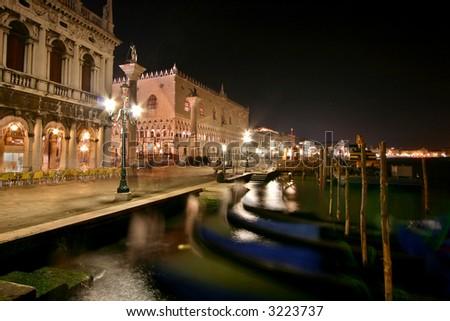 doge's palace and gondolas - stock photo