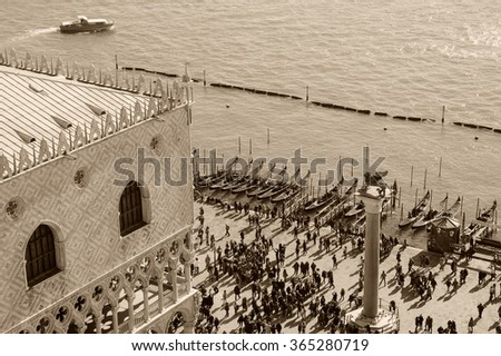 Doge's Palace (Palazzo Ducale) and touristic crowd on the at St. Mark's Square during the Carnival in Venice (Italy). A view from above. Aged photo. Sepia. - stock photo