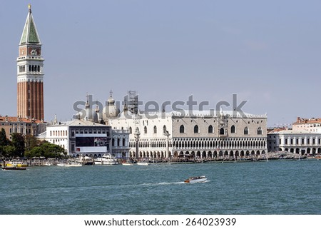 Doges palace, campanile of St. Marco, St. Marco lion statue, schiavoni quay  and water traffic in summer Venice - stock photo