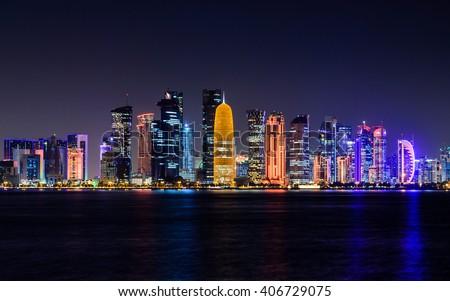 Doha city skyline illuminated at night. Qatar, Middle East - stock photo