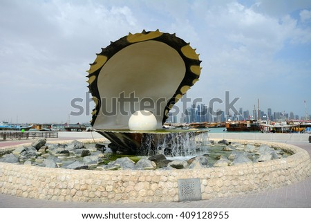 DOHA - MARCH 1 :The Pearl at 1 March, 2015 in Doha, Qatar. The statue of the pearl is the symbol of Doha City. - stock photo