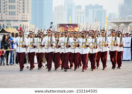 DOHA/QATAR - DECEMBER 18: Qatar Emiri Guards are performing military marches on Qatar National Day on the 18th of December 2012. The event is held on December 18th of every year since 2007. - stock photo