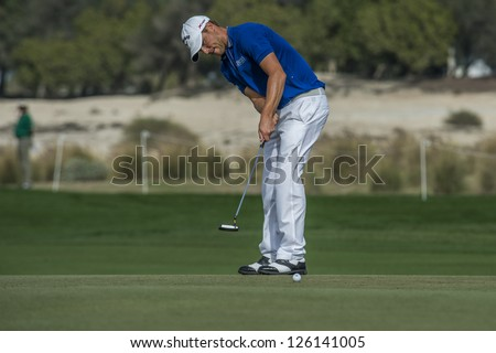DOHA, QATAR - JANUARY 26: Alexander Noren putts on the 9th hole during the US$2.5 million Commercial Bank Qatar Masters on January 26, 2013 in Doha Qatar.