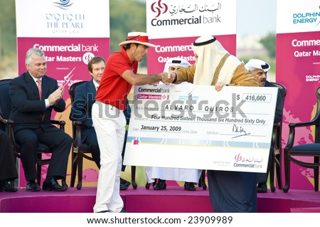 DOHA QATAR - 25 JANUARY 2009: Champion Quiros receives his prize cheque after winning the 2009 Commercial Bank Qatar Masters Tournament on 25 January in Doha, Qatar.