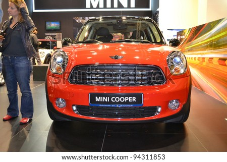 DOHA-QATAR - JANUARY 25 : Mini Cooper model on display at Qatar Motor Show Second Exhibition on January 25, 2012 in Doha, Qatar. The event is from January 25-28, 2012.