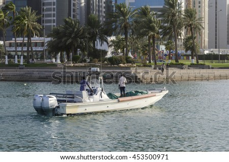 DOHA, QATAR - JULY 12: Doha Harbour with fishing boat during sunset. July 12, 2016 in Doha, Qatar, Middle-East.