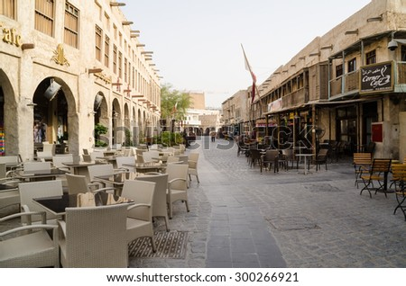 DOHA, QATAR - JULY 27, 2015: Souq Waqif is a main marketplace and a popular tourist attraction selling traditional garments, spices, handicrafts, and souvenirs. - stock photo