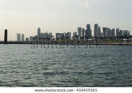 DOHA, QATAR - MARCH 13: The West Bay City skyline at evening. March 13, 2016 in Doha, Qatar, Middle-East.