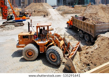 DOHA, QATAR - MAY 19: Construction continues unabated on May 19, 2010 in Doha. Qatar is hosting the 2022 Fifa football World Cup which already triggered a huge structural investment program - stock photo