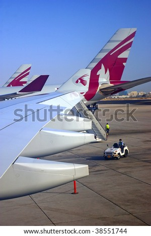 DOHA, QATAR - OCTOBER 1, 2009: Qatar airways planes at Doha international airport, Qatar. Qatar Airways further enhances it's reputation by winning TTG Airline of the year 2009 award, in London.