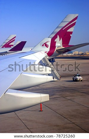 DOHA, QATAR - OCTOBER 1: Qatar airways planes sit on the tarmac at Doha airport, on October 1, 2009, Qatar. Awarded Best Middle Eastern Airline for the 5th year running at the 2010 TTG travel awards. - stock photo