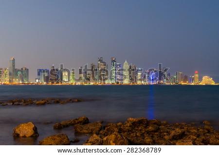 Doha skyline at night, Qatar, Middle East - stock photo
