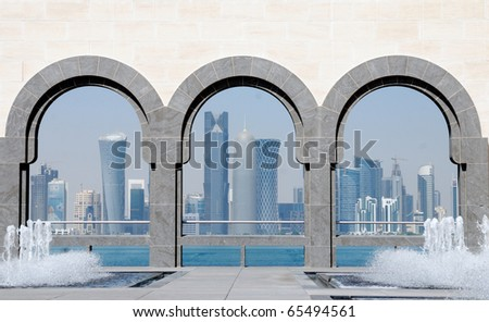 Doha skyline seen through the arches at the Museum of Islamic art, Doha, Qatar - stock photo