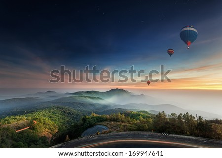 Doi Inthanon National park in the sunrise, mist and main road at Chiang Mai Province, Thailand - stock photo