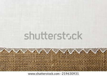 doily with handmade lace on burlap texture - stock photo
