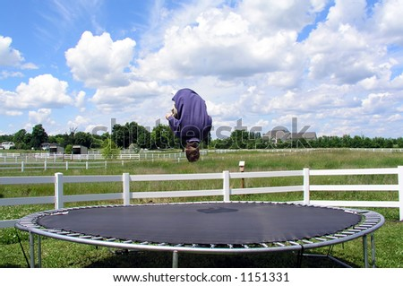 Doing a flip on a trampoline, stop-motion upside-down - stock photo