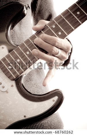 Doing a Full Bend on Electric Guitar - stock photo