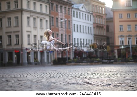 Doing a grand jete at the street - stock photo