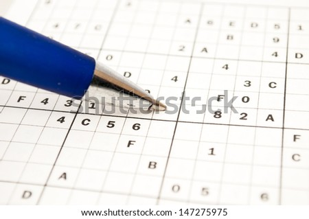doing a sudoku to train the mind - stock photo