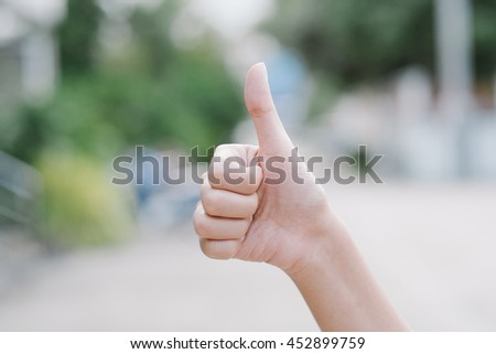 doing a Thumb up hand gesture - stock photo