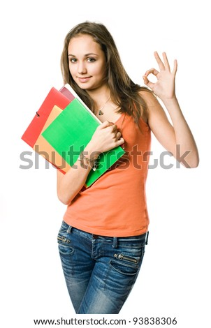 Doing fine here, half length portrait of beautiful young student girl showing ok sign. - stock photo