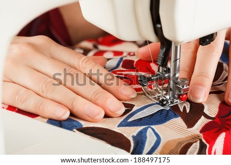 doing some sewing clothings on a sewing typewriter - stock photo