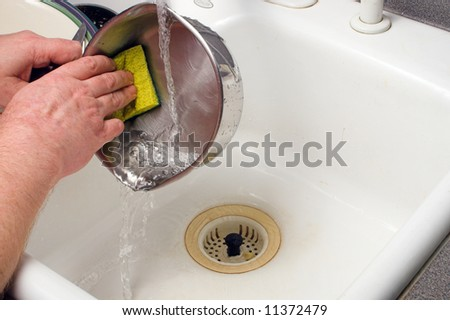 Doing the Dishes - stock photo