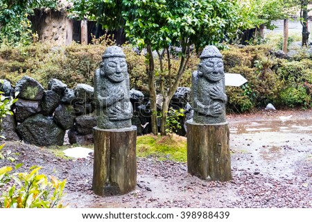 Dol hareubangs, statues on Jeju Island of South Korea on rainy. They are considered to be gods offering both protection and fertility