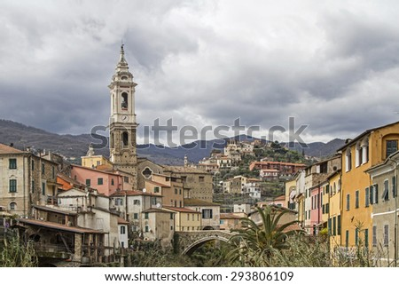 Dolcedo with the Ponte Grande, a bridge structure from the 13th century - stock photo