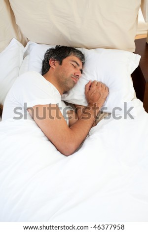 Doleful man sleeping after having an argument