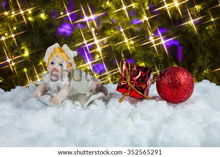 Doll and christmas decoration background. - stock photo