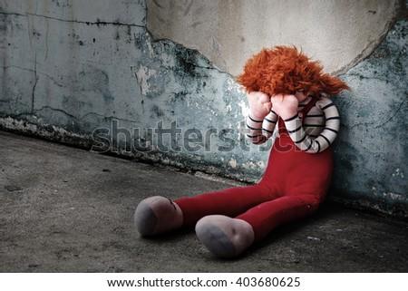 Doll Crying in dirty floor., Dark tone. - stock photo