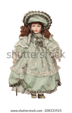 Doll in a beautiful dress on a white background - stock photo